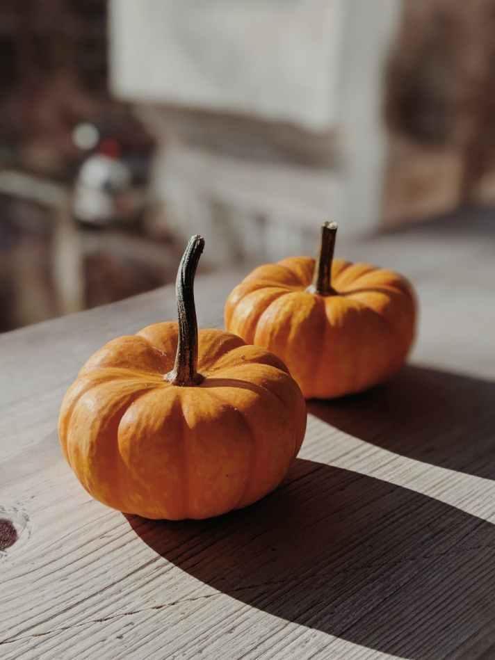 orange pumpkins on table